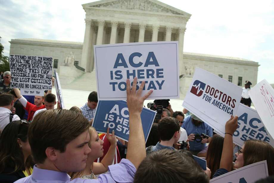 Demonstrators support Affordable Care Act outside the U.S. Supreme Court last summer. The court ruled that the health care law may provide nationwide tax subsidies to help those eligible buy health insurance. A reader sees judges legislating from the bench. Photo: DOUG MILLS /New York Times / NYTNS