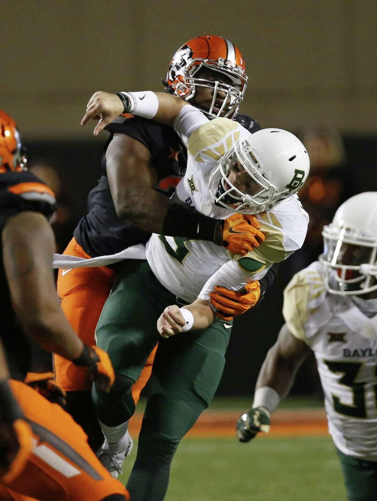 Oklahoma State defensive end Emmanuel Ogbah tackles Baylor quarterback Jarrett Stidham.