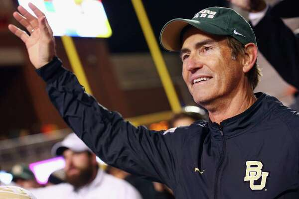 Head coach Art Briles of Baylor celebrates after the Bears beat the Oklahoma State Cowboys 45-35 at Boone Pickens Stadium.