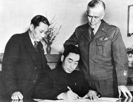 General ZHOU ENLAI, representative of the Chinese Communist Party, signing the Cease-Fire at the headquarters of George C. MARSHALL - President TRUMAN's envoy (right) in Chungking on January 23, 1946. On the left, governor CHANG CHUN. Le général CHOU EN-LAI représentant le parti communiste chinois appose sa signature au Cessez-le-Feu au quartier général de George C. MARSHALL - envoyé spécial du président TRUMAN (à droite) à Chungking. A gauche le gouverneur CHANG CHUN le 23 janvier 1946.