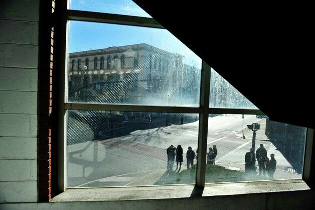 Seen from the stairwell of the parking garage, representatives from CDTA give a tour of the future CDTA Troy Transit Center at Fulton St. and Fourth St. on Monday, Nov. 23, 2015, in downtown Troy, N.Y. (Paul Buckowski / Times Union) Photo: PAUL BUCKOWSKI / 10034394A