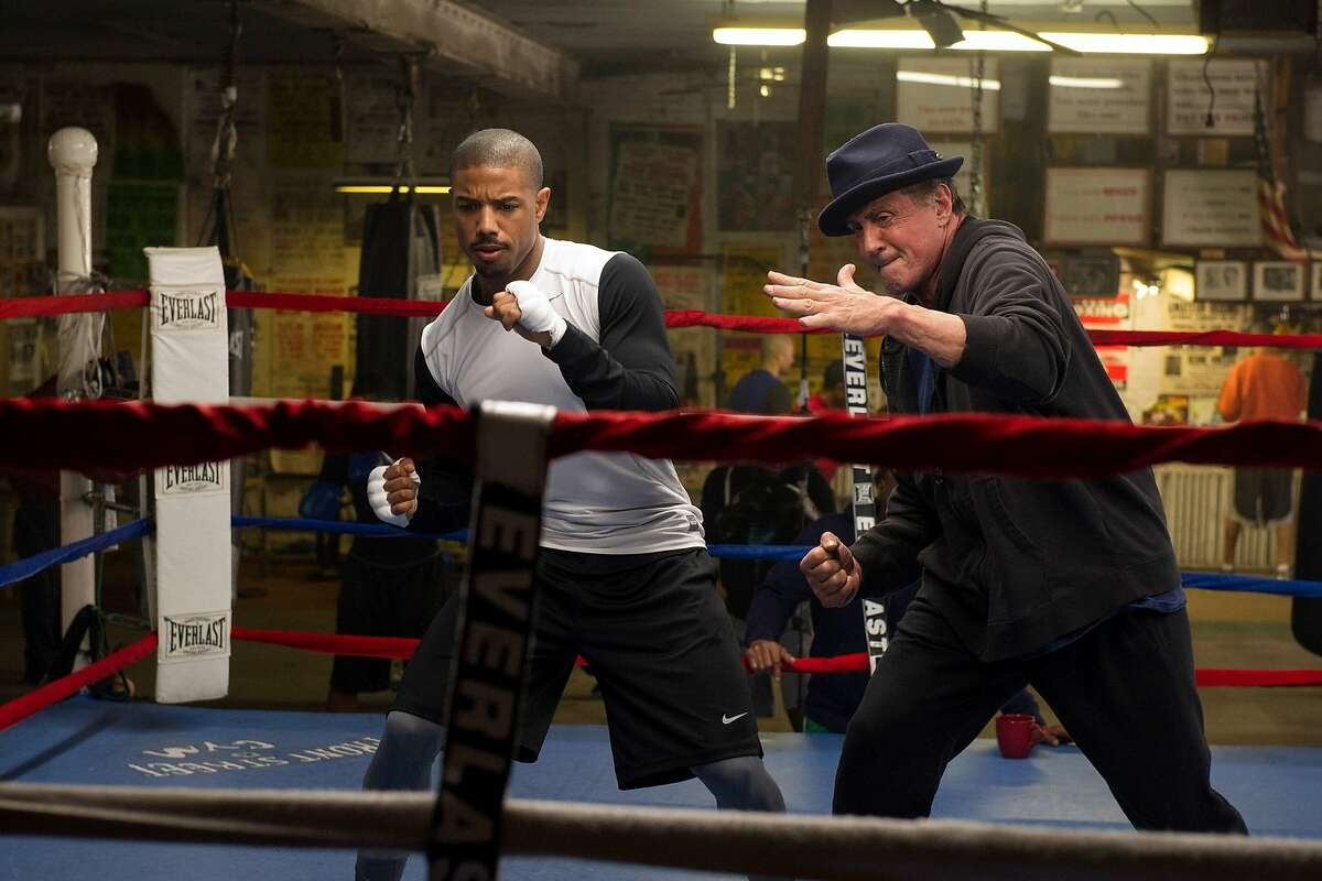 (L-r) Michael B. Jordan is Apollo Creed's son, with Sylvester Stallone reprising his iconic role as Rocky Balboa, in