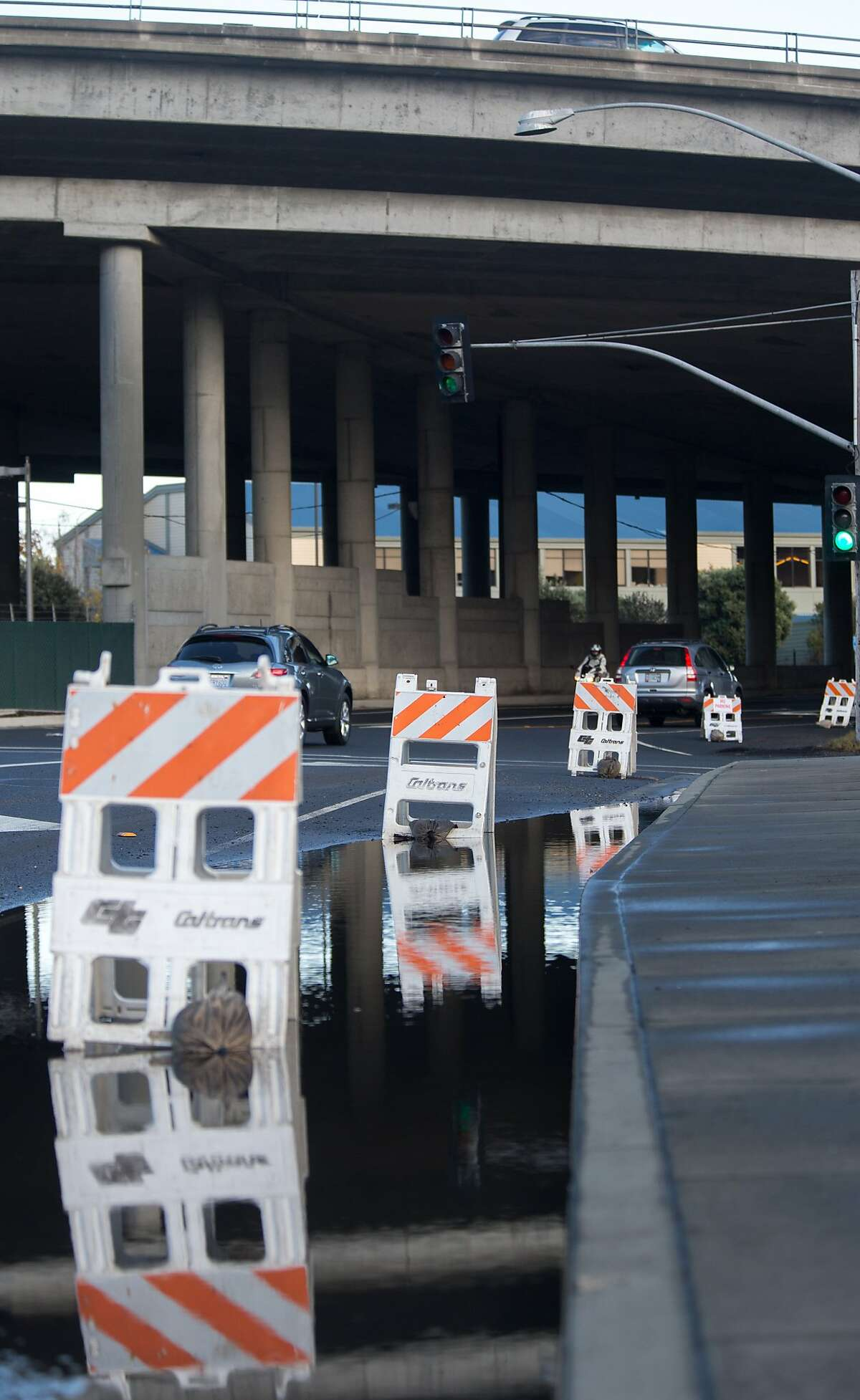 Signs of flooding are seen at the Park and Ride lot on Monday, Nov. 23, 2015 in Mill Valley, Calif.