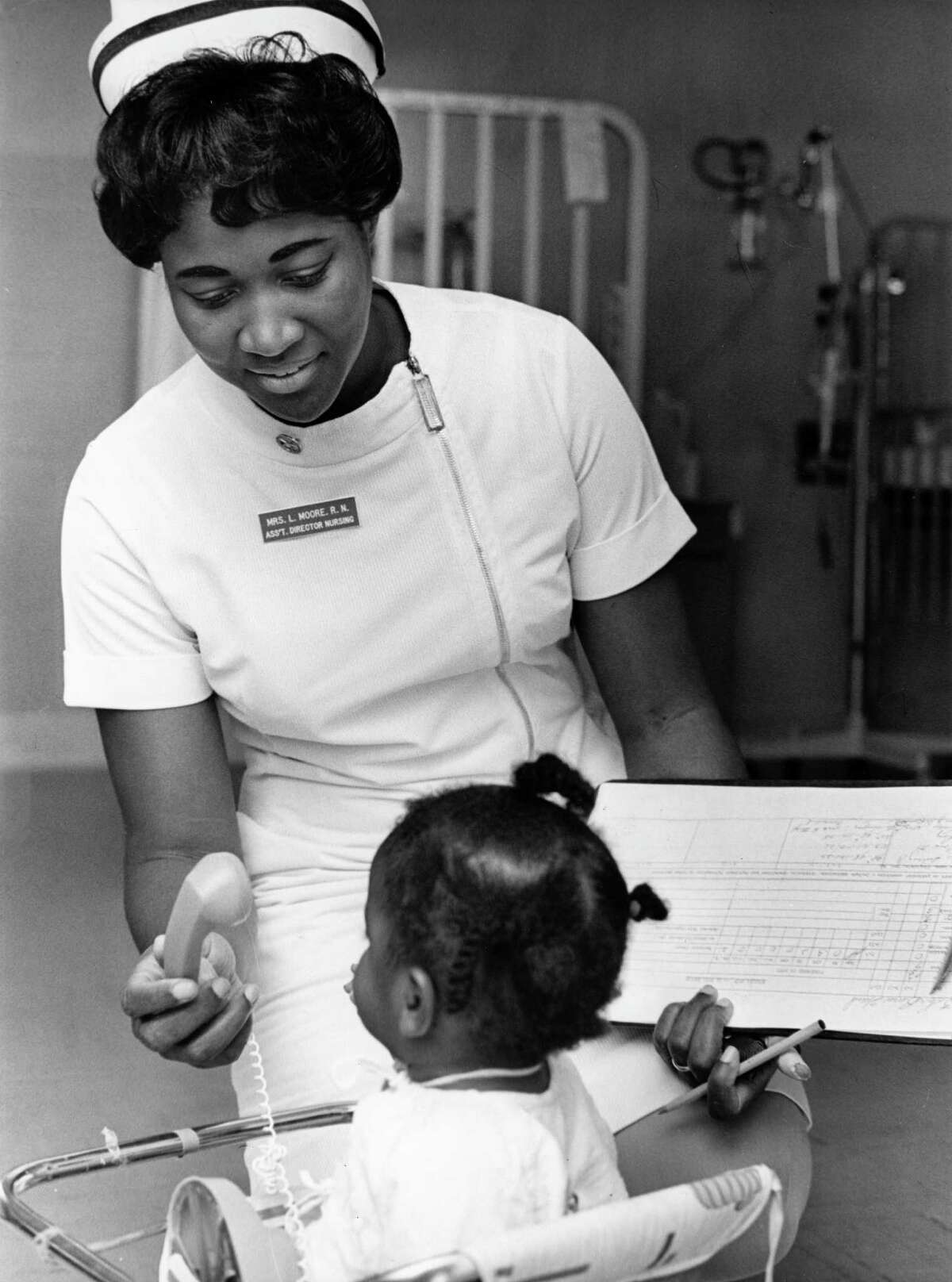 12/1968 - Lois Moore, assistant director of Nursing at Ben Taub Hospital, often stops to see younger patients.