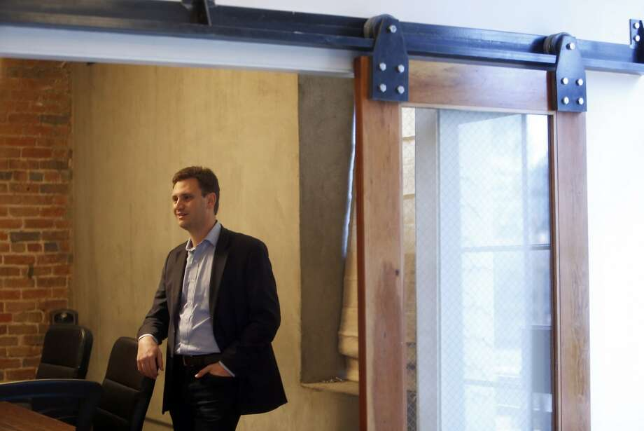 Aspiration CEO Andrei Cherney visits with Bright Funds CEO Ty Walrod in San Francisco, Calif., on Monday, November 23, 2015. Photo: Scott Strazzante, The Chronicle