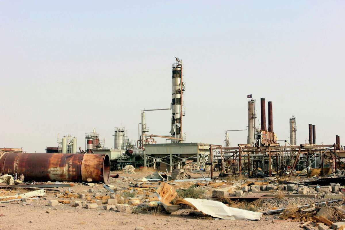 A bombing raid damaged this refinery 155 miles north of Baghdad in a part of Iraq controlled by Islamic State militants. (AP Photo)