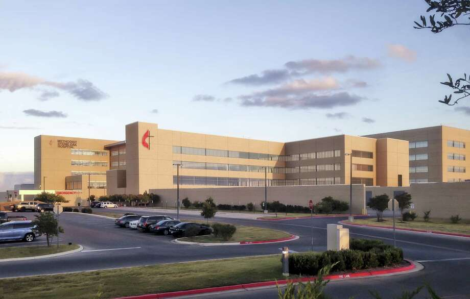 Methodist Stone Oak Hospital is expanding by more than 100,000 square feet, adding 71 inpatient beds to the hospital. The new addition, shown in the center of this rendering, features a tower marked with a cross and a flame and an adjoining L-shaped building with glass windows. Photo: Methodist Healthcare System