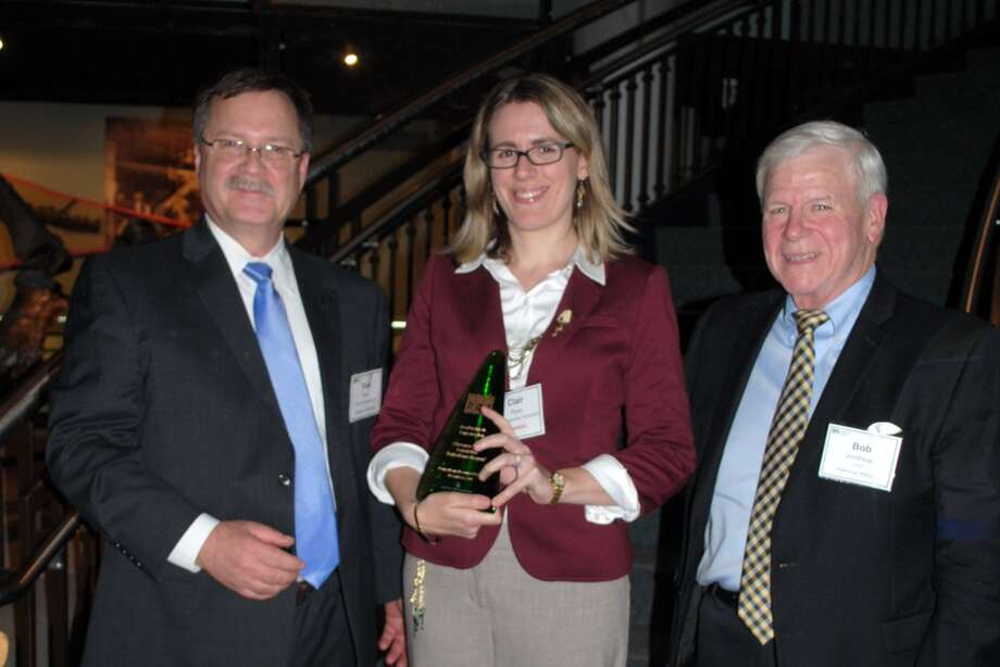Guilderland High School graduate Clair Ryan (Class of 2000), center, Chesapeake Bay Foundation Pennsylvania's watershed restoration program manager, holds the 2015 Leadership Conservation Award, presented by the Pennsylvania Resources Council. CBF earned the award for accelerating the planting of streamside buffers. At left, is Tomlinson Fort of Apex Companies, PRC board chair and at right is Bob Jondreau, PRC executive director. The award was presented at Drexel University in Philadelphia on Nov. 12. (Pennsylvania Resources Council) Photo: Picasa