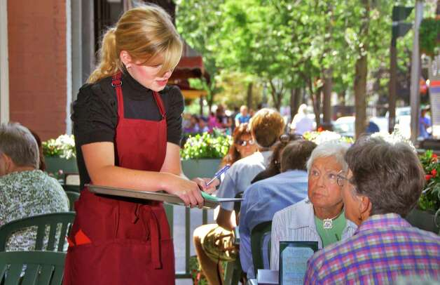 Collen Lauko, 23, left, of Malta, takes lunch orders at Lillian's Restaurant on Broadway in Saratoga Springs Wednesday afternoon, Aug. 27, 2008. (John Carl D'Annibale / Times Union) Photo: John Carl D'Annibale / Albany Times Union