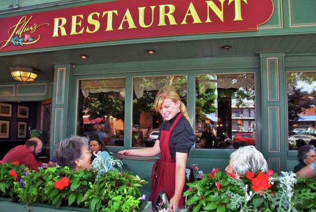 Collen Lauko, 23, center, of Malta, takes lunch orders at Lillian's Restaurant on Broadway in Saratoga Springs Wednesday afternoon, Aug. 27, 2008. (John Carl D'Annibale / Times Union) Photo: John Carl D'Annibale / Albany Times Union