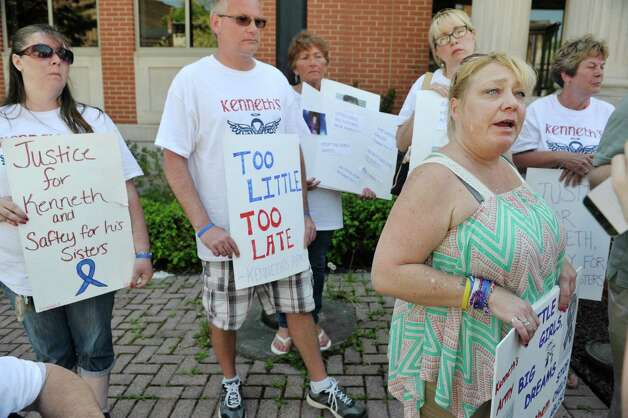 Michelle Fusco, right, from Knox talks to members of the media outside of Albany County Family Court following a hearing on Monday, May 11, 2015, in Albany, N.Y.  The group calling themselves Kenneth's Army, after slain 5-year-old Kenneth White.  The Family Court hearing was on the two sisters of Kenneth White. (Paul Buckowski / Times Union) Photo: PAUL BUCKOWSKI / 00031791A