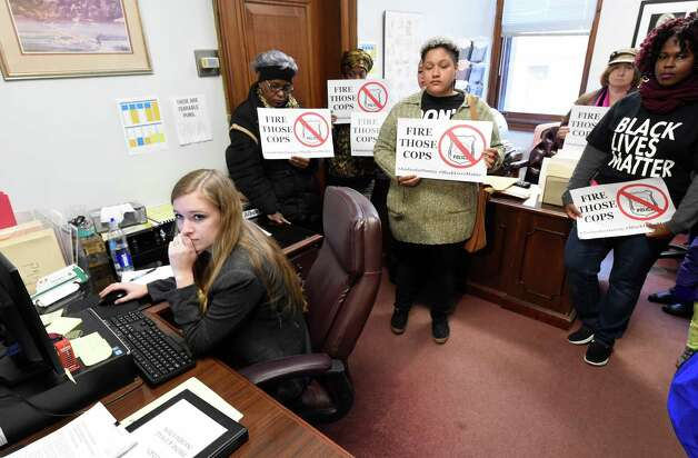 Angelica Clarke, center waits to hand a list of demands regarding the Dontay Ivy case to Mayor Kathy Sheehan, who was out of the office for the afternoon at City Hall Nov. 23, 2015 in Albany, N.Y.   (Skip Dickstein/Times Union) Photo: SKIP DICKSTEIN / 10034403A