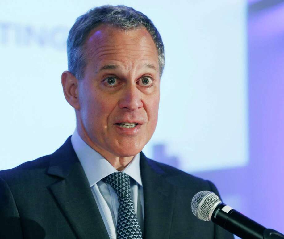 FILE - In this Sept. 19, 2014, file photo, New York State Attorney General Eric Schneiderman speaks during an annual meeting of the Business Council of New York State at the Sagamore Resort in Bolton Landing, N.Y. Scheniderman recently took on the fantasy football industry by ordering industry giants DraftKings and FanDuel to stop accepting play from New Yorkers. Schneiderman said that activity amounts to illegal gambling but they say he misinterpreted their business, and they've asked a court to block his order. (AP Photo/Mike Groll, File) ORG XMIT: NYR403 Photo: Mike Groll / AP