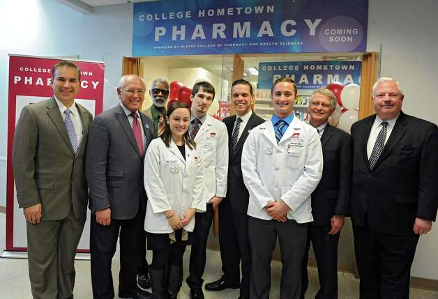 Pharmacy students pose for a photo with officials during a press conference at the Hometown Health Center on Monday, Nov. 23, 2015 in Schenectady, N.Y. People gathered for an announcement of a first-of-a kind alliance in the Capital Region between Hometown Centers (HHC), the countyOs only not-for-profit, federally qualified health center, and Albany College of Pharmacy and Health Sciences (ACPHS). (Lori Van Buren / Times Union) Photo: Lori Van Buren / 10034397A