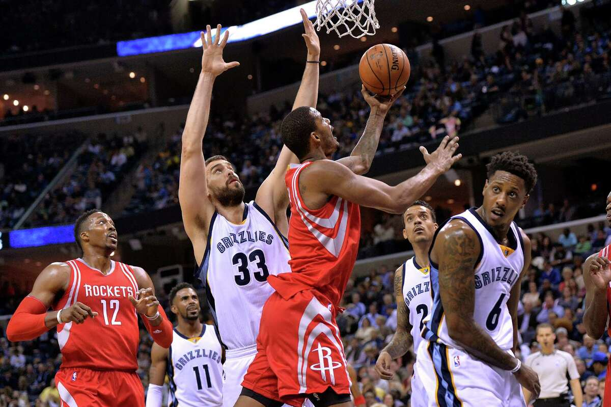 The Rockets' Trevor Ariza attempts a reverse layup in Friday's loss to the Grizzlies. The team's shooting woes run the gamut. They are last in 3-point accuracy at 29.6 percent and fell from first to 11th in points scored in the paint.
