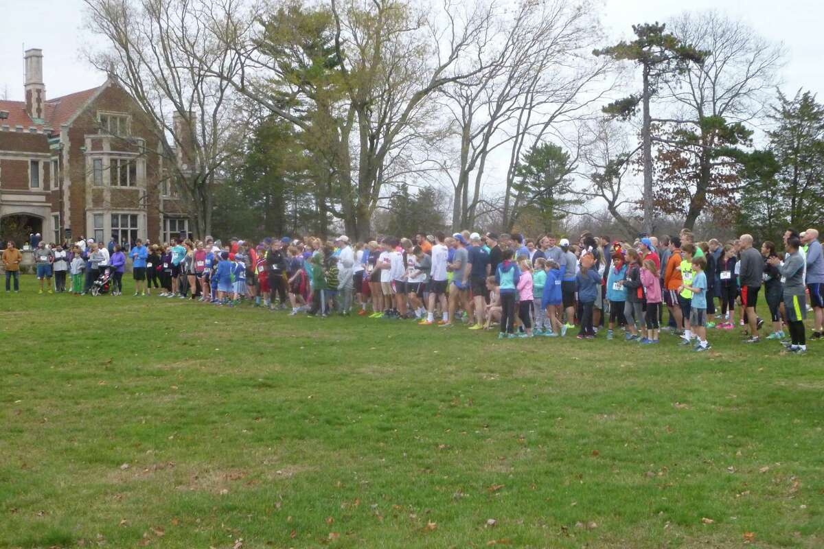 Runners get ready at the starting line in the 12th Annual New Canaan Turkey Trot, a 5K run/walk through Waveny Park in New Canaan held Sunday, Nov. 22.