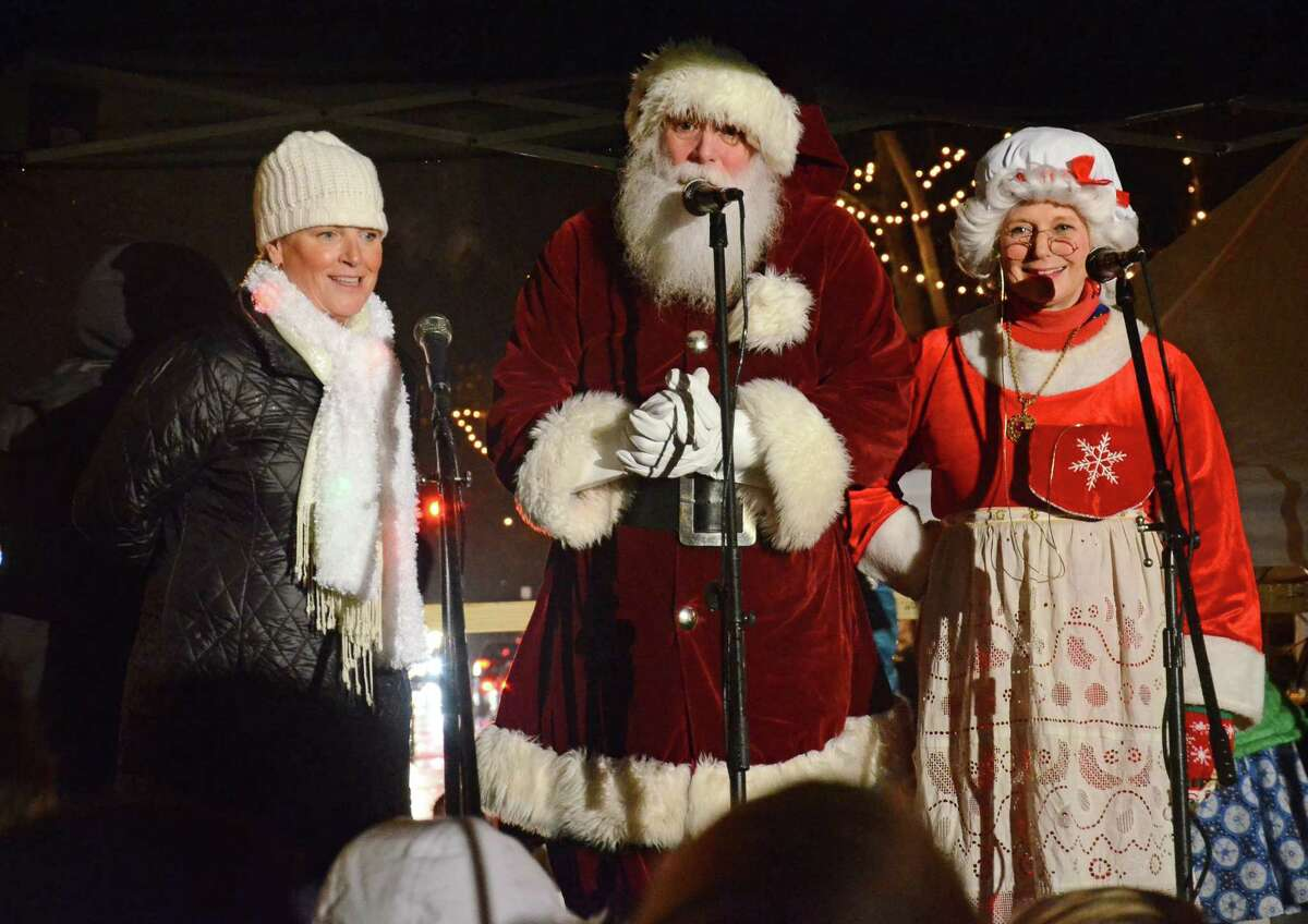 New Canaan Chamber of Commerce Executive Director Tucker Murphy, left, with Santa Claus and Mrs. Clausat last year's Holiday Stroll in New Canaan.