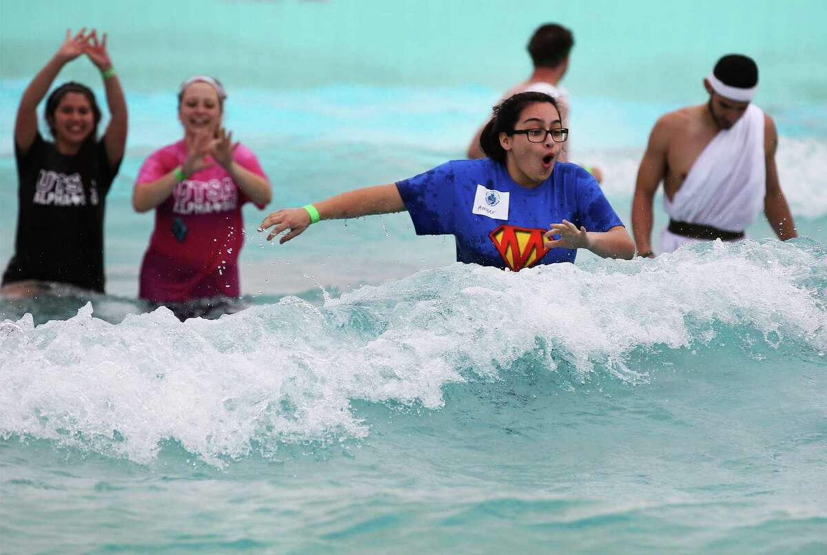 Amber Lewand reacts to a wave of chilly water last December while taking part in the Texas Special Olympics' Polar Plunge at SeaWorld's Aquatica water park in San Antonio. SeaWorld San Antonio is making Aquatica a stand-alone attraction.
