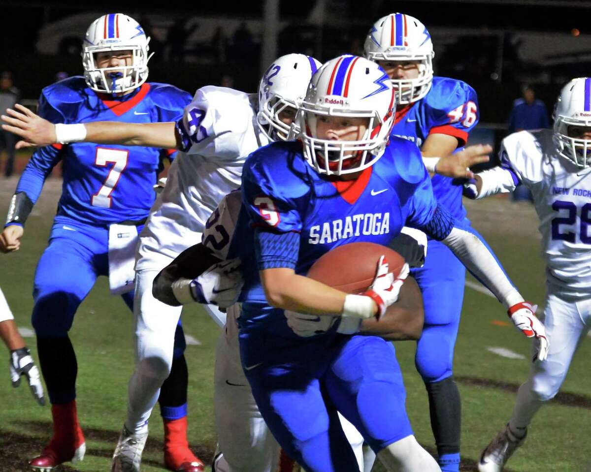 Saratoga's #3 carries for yardage during their Class AA semifinal game against New Rochelle Saturday Nov. 21, 2015 in Kingston, NY. (John Carl D'Annibale / Times Union)