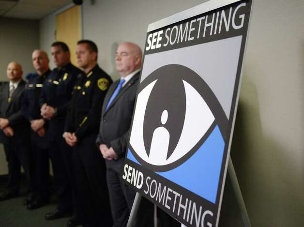 A new law enforcement app for reporting suspicious activity is introduced Monday morning, Nov. 23, 2015, during a press conference at Albany International Airport in Colonie, N.Y. The new app, See Something, Send Something, allows you to photograph suspicious packages, activities or other items that raise concern and send the photo and message to the nearest state police or homeland security center, where it's evaluated and can be acted on. It is available at the Google Play and the Apple App store.  (Will Waldron/Times Union) Photo: Will Waldron / 10034404A