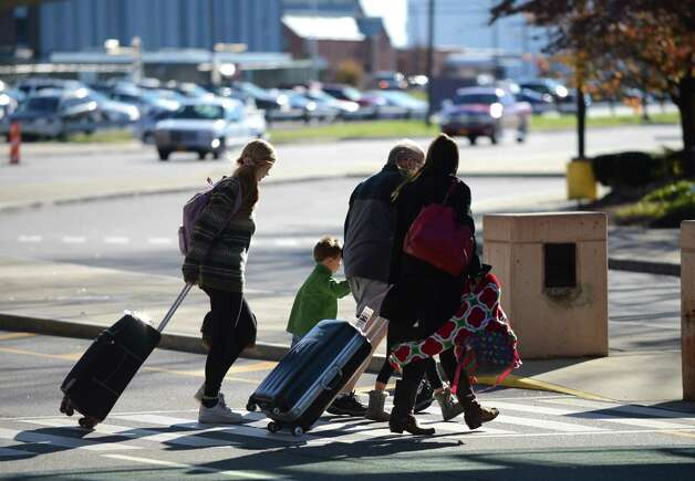 Passengers leave Albany International Airport after landing Monday lunchtime, Nov. 23, 2015, in Colonie, N.Y.  (Will Waldron/Times Union) Photo: Will Waldron / 10034406A