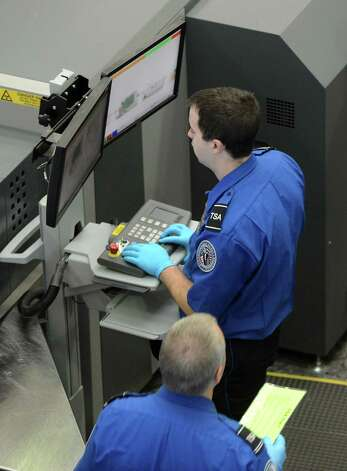 TSA personnel conduct passenger inspections at Albany International Airport's security checkpoint Monday lunchtime, Nov. 23, 2015, in Colonie, N.Y.  (Will Waldron/Times Union) Photo: Will Waldron / 10034406A