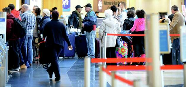 Passengers lineup at the Delta Airlines ticket counter Monday lunchtime, Nov. 23, 2015, at Albany International Airport in Colonie, N.Y.  (Will Waldron/Times Union) Photo: Will Waldron / 10034406A
