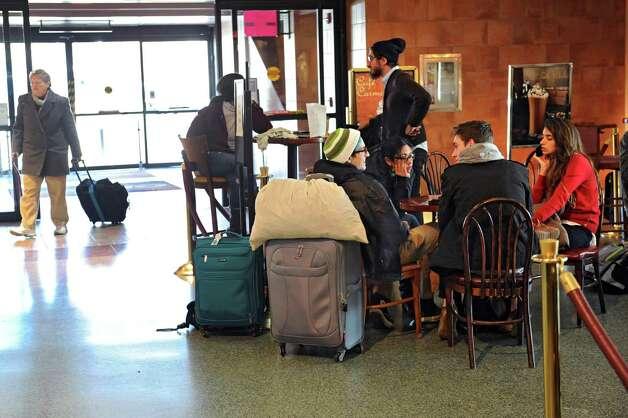 Travelers wait for their train at the Albany-Rensselaer Amtrak Train Station on Monday, Nov. 23, 2015 in Rensselaer , N.Y.  (Lori Van Buren / Times Union) Photo: Lori Van Buren / 10034406A