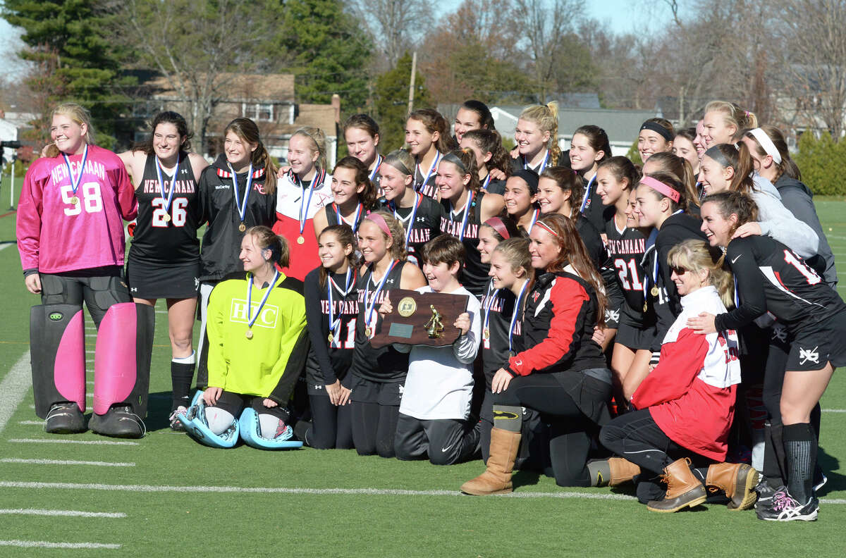 New Canaan celebrates their win over Barlow during the CIAC State Field Hockey Tournament Class M Finals vs Joel Barlow at Wethersfield High School in Wethersfield, Conn. on Saturday, Nov. 21, 2015.