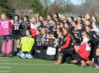 New Canaan celebrates their win over Barlow during the CIAC State Field Hockey Tournament Class M Finals vs Joel Barlow at Weth