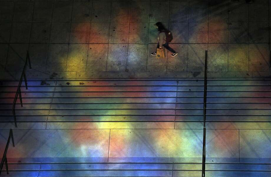 A pedestrian walks by the front of Grace Cathedral as seen from a balcony above the rose window in San Francisco, Calif., on Monday, November 23, 2015. Photo: Carlos Avila Gonzalez, The Chronicle