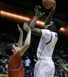 California's Jaylen Brown, right, shoots against Sam Houston State's Albert Almanza, left, in the second half of an NCAA college basketball game Monday, Nov. 23, 2015, in Berkeley, Calif. (AP Photo/Ben Margot)