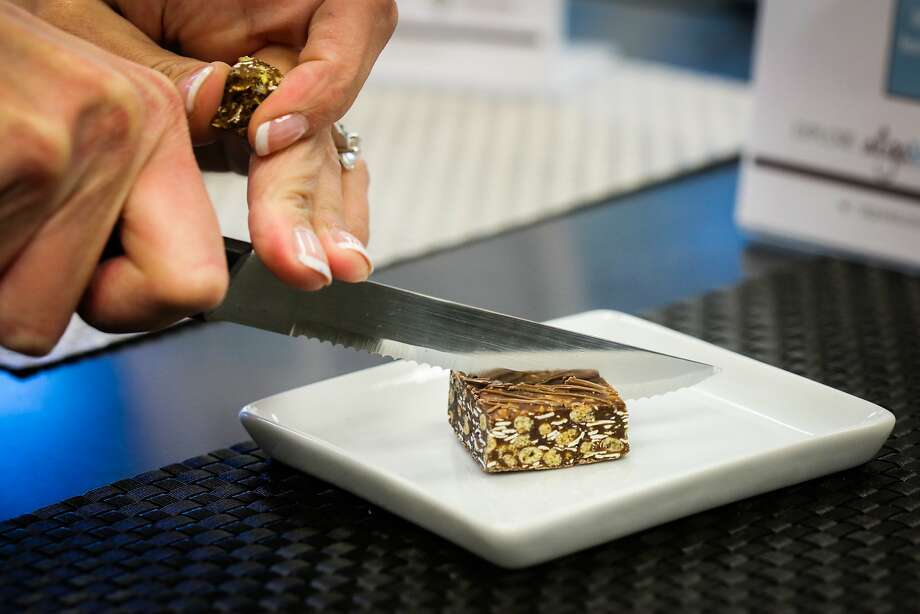 Katie Ringer, marketing manager at Solazyme, cuts up samples of a protein bar made with Solazyme's non-toxic algae as a protein base, in their test kitchen in South San Francisco, California on Friday, November 20, 2015. Photo: Gabrielle Lurie, Special To The Chronicle