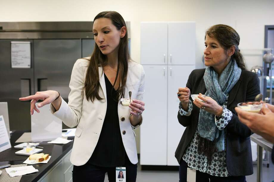 Katie Ringer (left) and Jill Kauffman (right), both employees of biotech company Solazyme, taste a sample of ice cream that uses non-toxic algae flour to lower the fat content, at Solazyme's test kitchen in South San Francisco, California on Friday, November 20, 2015. Photo: Gabrielle Lurie, Special To The Chronicle