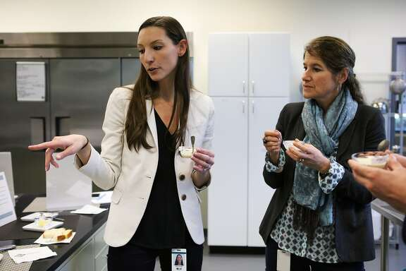 Katie Ringer (left) and Jill Kauffman (right), both employees of biotech company Solazyme, taste a sample of ice cream that uses non-toxic algae flour to lower the fat content, at Solazyme's test kitchen in South San Francisco, California on Friday, November 20, 2015.