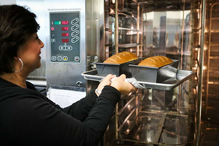 Kathy Samuelson, a Food Specialist at Solazyme, takes out freshly baked bread that is being used for testing, in South San Francisco, California on Friday, November 20, 2015. Solazyme is a biotech company which uses non-toxic algae as a protein base to replace common food products. Photo: Gabrielle Lurie, Special To The Chronicle