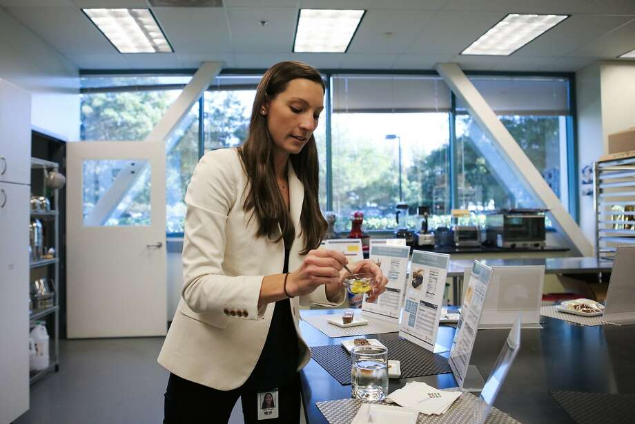 Katie Ringer, marketing manager at Solazyme, tastes a sample of nontoxic algae flour, at Solazyme''s test kitchen in South San Francisco. Photo: Gabrielle Lurie, Special To The Chronicle