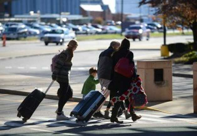 Travelers arrive at Albany International Airport (Will Waldron/Times Union)