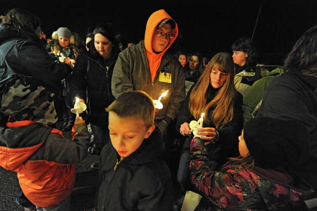 Community members come together for a vigil to honor Kenneth White in front of the Berne-Knox-Westerlo Elementary School on Monday, Dec. 22, 2014 in Berne, N.Y. White was killed last week. A suspect is in custody. (Lori Van Buren / Times Union) Photo: Lori Van Buren / 00029956A