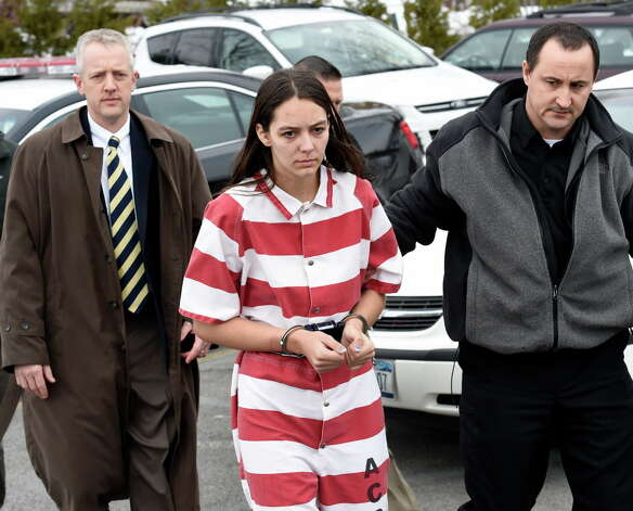 Tiffany VanAlstyne, 19, is escorted out of Knox Town Court Friday afternoon, Dec. 19, 2014, in Knox, N.Y., where she was arraigned on 2nd degree murder charges for the alleged strangulation death of her cousin, 5-year-old Kenneth White. The teenager pleaded not guilty. She was sent to the Albany County jail without bail. (Skip Dickstein/Times Union) Photo: SKIP DICKSTEIN