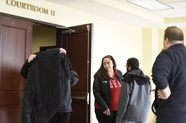 Brenda VanAlstyne, in red, leaves Albany County Court with family members on Tuesday, Nov. 24, 2015, after her daughter Tiffany VanAlstyne accepted a plea deal in the death of Kenneth White, 5. (Skip Dickstein/Times Union)