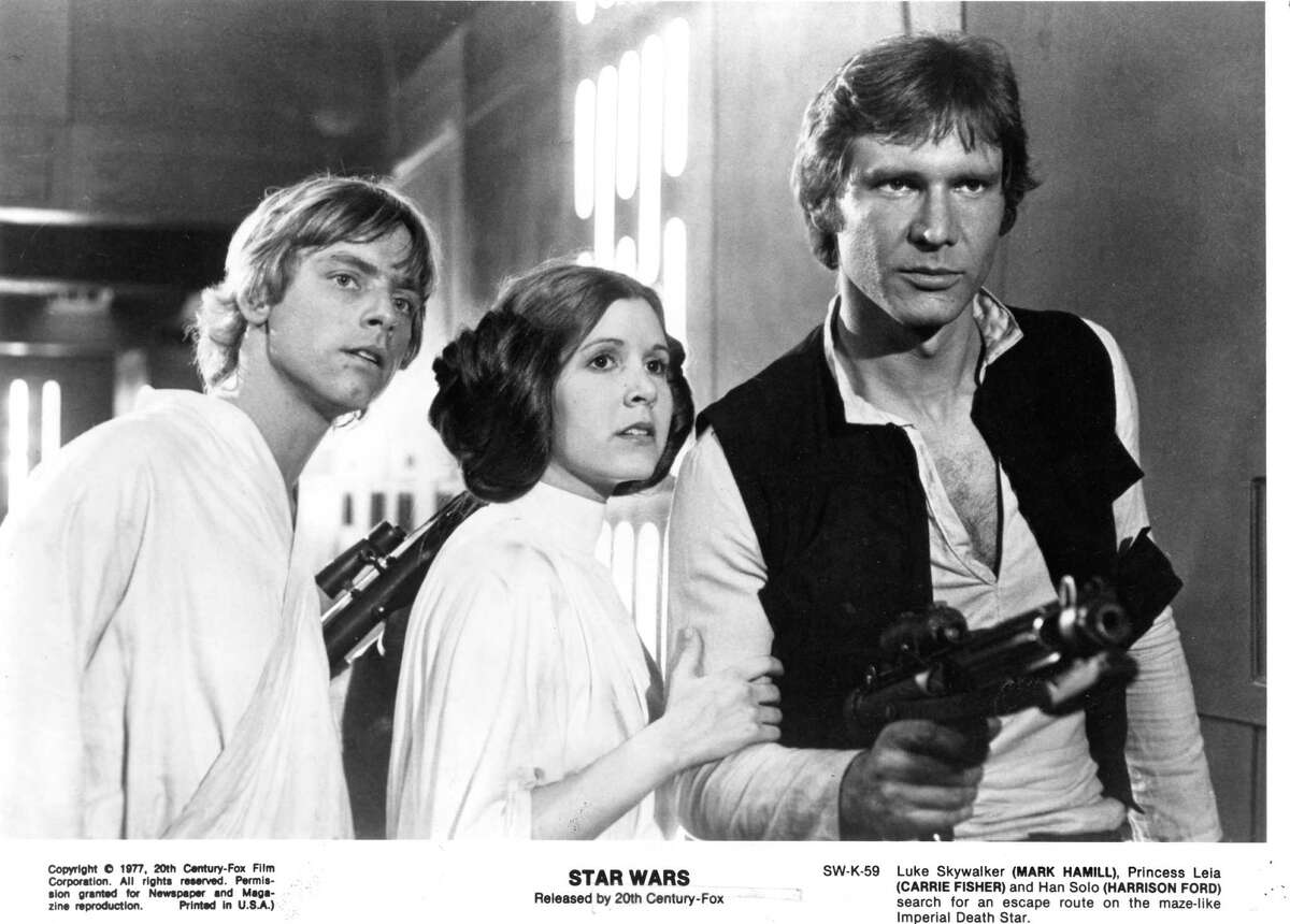Mark Hamil, left, Carrie Fisher and Harrison Ford help launch the megahit