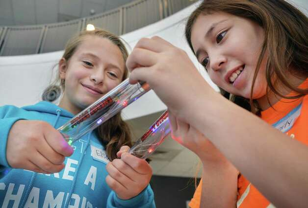 "Burnt Hills Ballston Lake elementary fifth graders Elsa Newman, left, and Trinity Nolan conduct an circuitry experiment during ""NanoDiscovery Day"" at SUNY Poly as students to learn about the world of Nanotechnology  Tuesday Nov. 24, 2015 in Albany, NY. (John Carl D'Annibale / Times Union) Photo: John Carl D'Annibale / 10034418A"