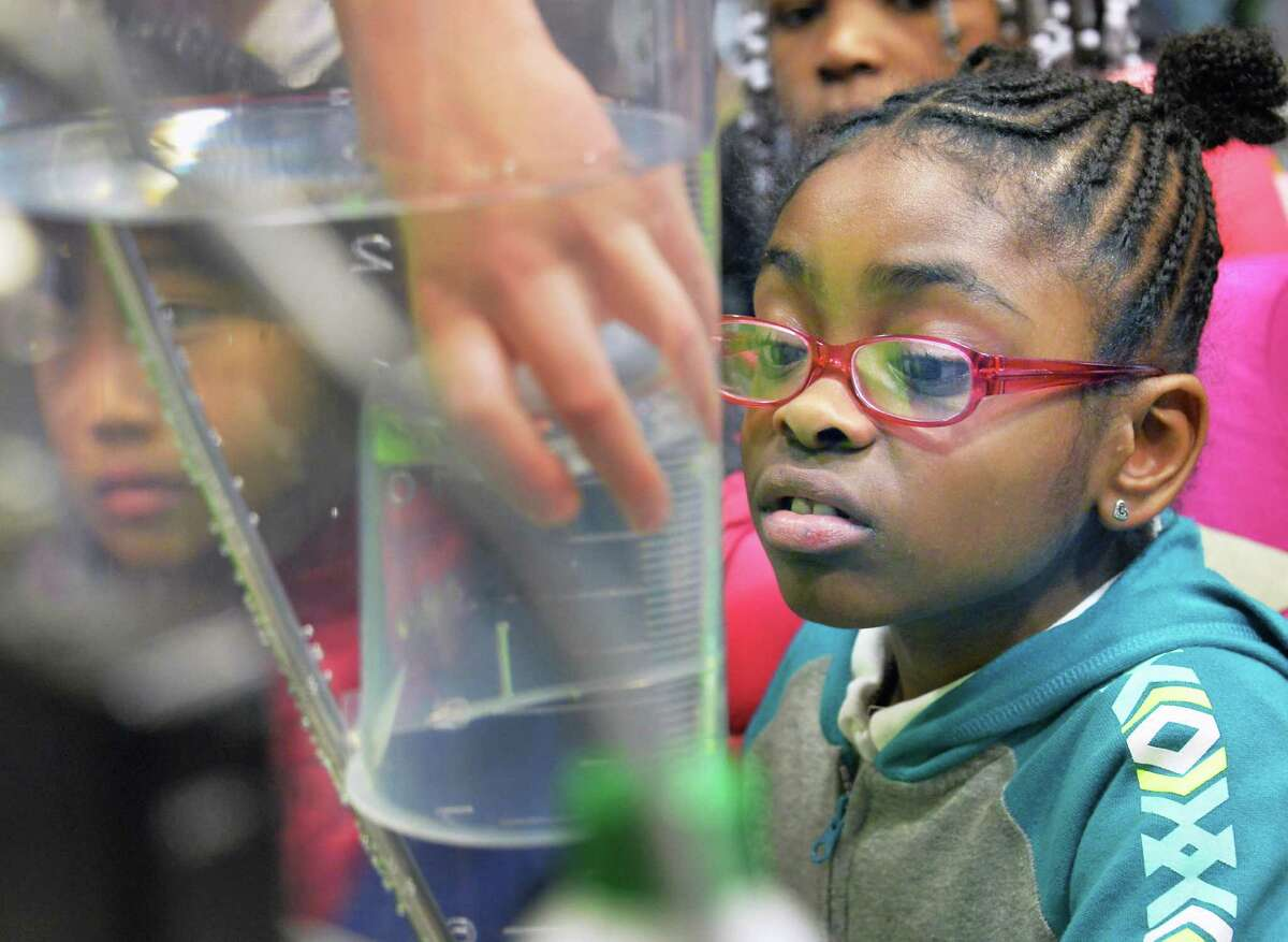 Thomas O'Brien Academy of Science and Technology (TOAST) second grader Brooklyn Payne watches as displacement experiment during NanoDiscovery Day at SUNY Poly as students to learn about the world of Nanotechnology Tuesday Nov. 24, 2015 in Albany, NY. (John Carl D'Annibale / Times Union)