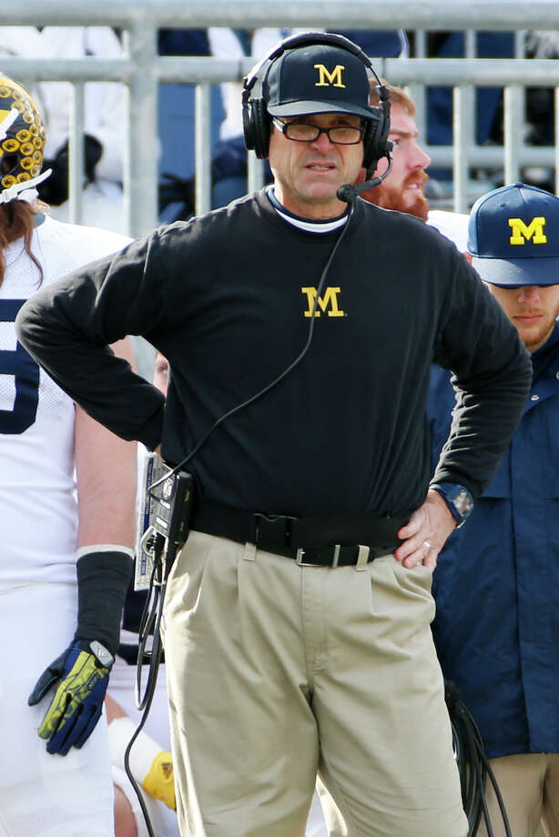 1242 x 1861~~$~~Michigan head coach Jim Harbaugh stands on the sidelines during an NCAA college football game against Penn State in State College, Pa., Saturday, Nov. 21, 2015. Photo: Gene J. Puskar, AP / AP