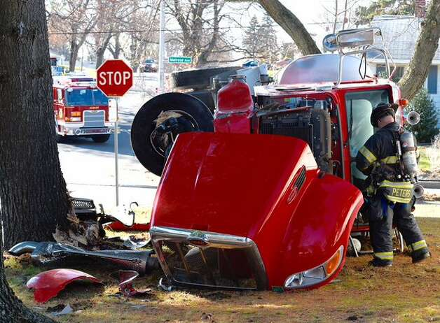 A Main-Care Energy truck rolled over Tuesday, Nov. 24, 2015, on a Melrose Avenue, Albany, lawn. (Skip Dickstein/Times Union)