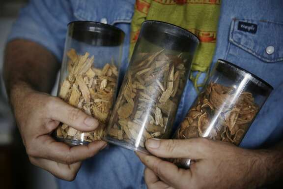 Tom Price, director of Strategic Initiatives, holds different samples of woody biomass that are used in All Power Labs products on Monday, November 23,  2015 in Berkeley, Calif.