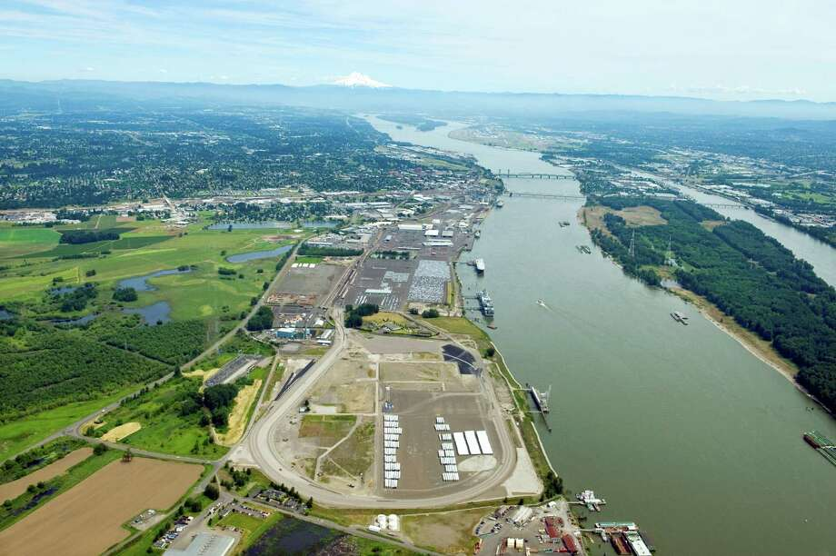 Tesoro Corp., with partner Savage Cos., want to deliver crude oil by rail to the area in the foreground of this aerial photo of the Port of Vancouver USA on the Columbia River. A marine dock also will be added at the port. Photo: Port Of Vancouver USA
