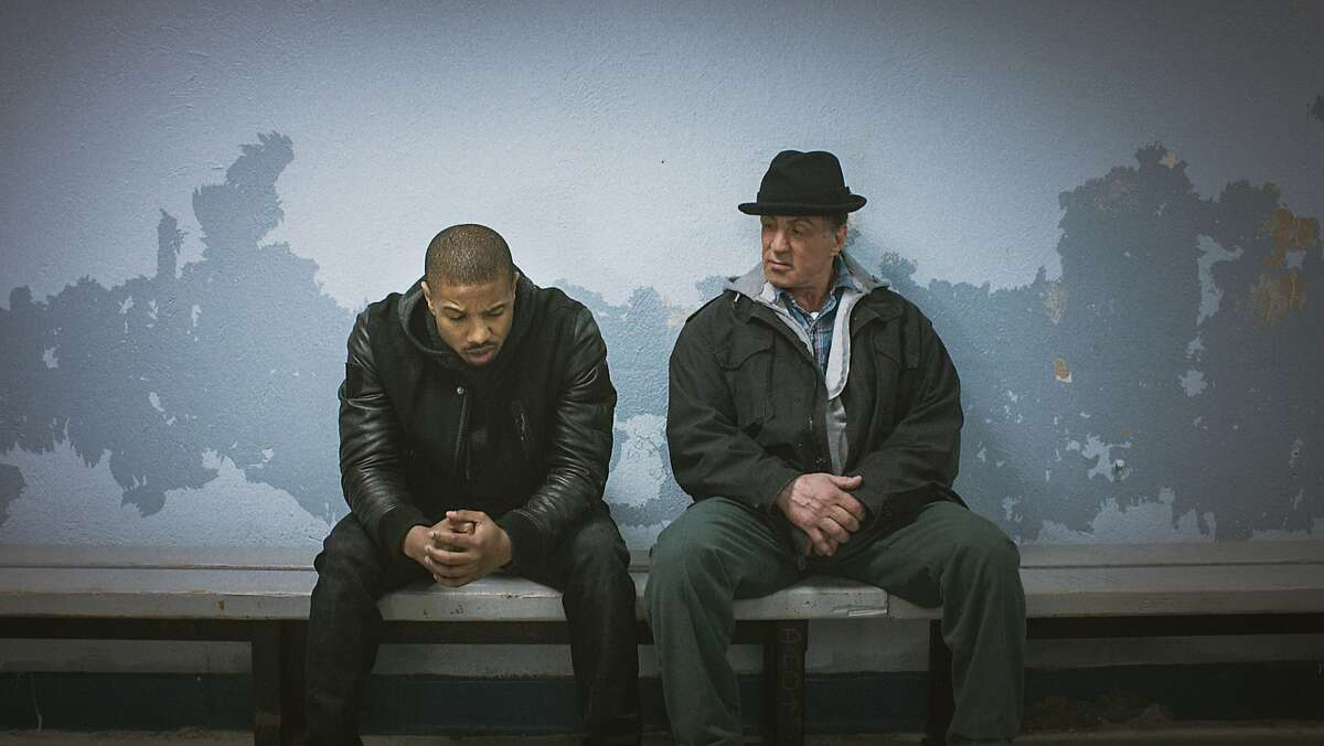 """This photo provided by Warner Bros. Pictures shows Michael B. Jordan, left, as Adonis Johnson and Sylvester Stallone as Rocky Balboa in Metro-Goldwyn-Mayer Pictures', Warner Bros. Pictures' and New Line Cinema's drama """"Creed,"""" a Warner Bros. Pictures release. The movie opens in U.S. theaters on Nov. 25, 2015. (Warner Bros. Pictures via AP)"""