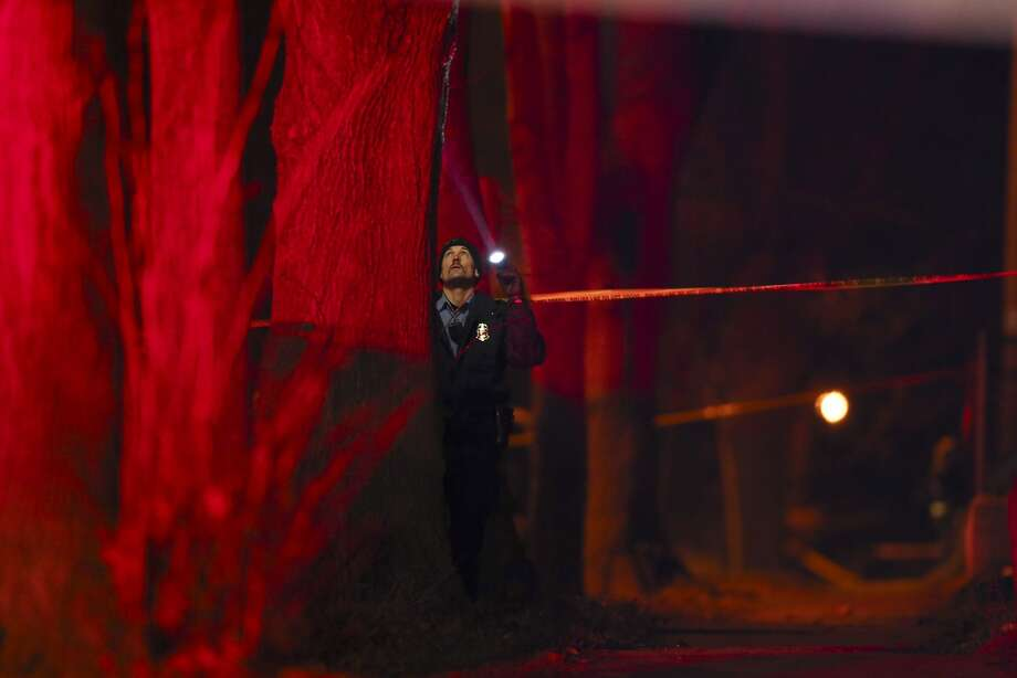 A Minneapolis police officer investigates the site where five Black Lives Matter activists who were protesting the Nov. 15 fatal shooting by police of Jamar Clark were shot. Photo: Jeff Wheeler, Associated Press